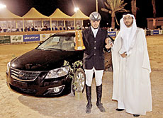 Abdullah Waleed Al-Sharbatly, winner of the Equestrian Championship, with the Toyota Aurion